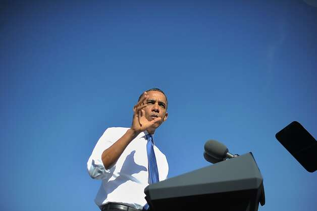 US President Barack Obama speaks about the importance of American workers developing American-made energy to an economy that's built to last at the UPS in Las Vegas, Nevada, on January 26, 2012. Obama denied Republican claims he was waging class warfare as he set out to sell his call for tax hikes on the rich in states crucial to his reelection bid. AFP Photo/Jewel Samad (Photo credit should read JEWEL SAMAD/AFP/Getty Images) Photo: Jewel Samad, AFP/Getty Images
