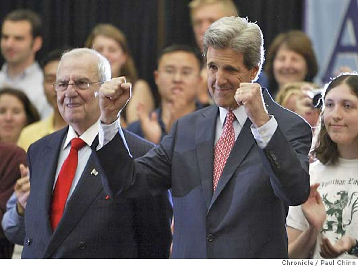 John Kerry (right) acknowledges the cheering crowd as he and Lee Iacocca (left) arrive for the rally. Iacocca announced he's endorsing the democratic candidate for president. Democratic presidential candidate Sen. John Kerry campaigns at SJSU in San Jose on 6/24/04. PAUL CHINN/The Chronicle