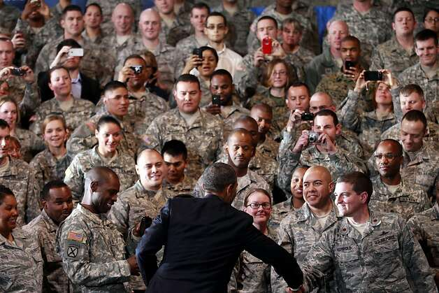 President Barack Obama greets service members before speaking at Buckley Air Force Base, Colo., Thursday, Jan. 26, 2012. (AP Photo/Haraz N. Ghanbari) Photo: Haraz N. Ghanbari, Associated Press