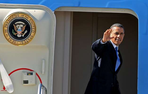 President Barack Obama waves as he boards Air Force One departing Las Vegas, Thursday, Jan. 26, 2012 after spending the night.  He spoke about energy innovations and promoted alternative fuels today at a United Parcel Service hub in Las Vegas  (AP Photo/John Gurzinski) Photo: John Gurzinski, Associated Press
