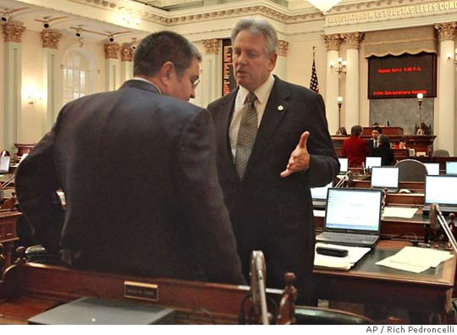 Republican Assemblyman Keith Richman of Chatsworth, right, talks with Democratic Assemblyman Joe Canciamilla of Pittsburg, during a recess of the Assembly at the Capitol in Sacramento,Calif., Thursday, Dec. 11, 2003. The two lawmakers have been leaders of an bipartisan group trying to reach a compromise on the budget negotiations between Gov. Arnold Schwarzenegger and the legislature. A budget deal is expected to be voted on by the Assembly later in the day. (AP Photo/Rich Pedroncelli) Republican Assemblyman Keith Richman of Chatsworth (right) talks with Democratic Assemblyman Joe Canciamilla of Pittsburg during a recess of the Assembly. Republican Assemblyman Keith Richman (right) talks with Democratic Assemblyman Joe Canciamilla of Pittsburg during a recess of the Assembly. CAT Photo: RICH PEDRONCELLI