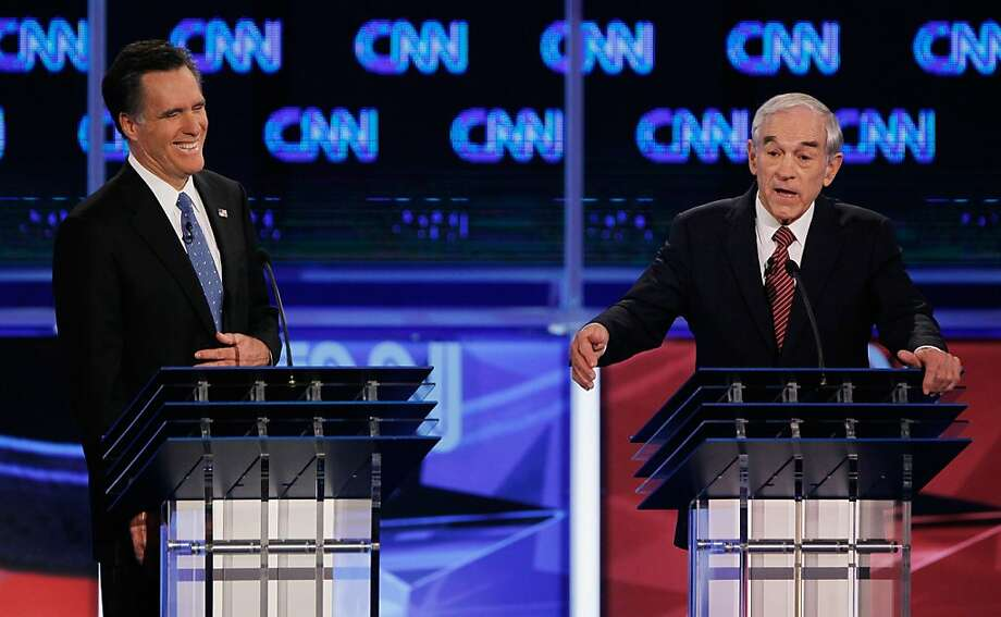 JACKSONVILLE, FL - JANUARY 26:  Republican presidential candidates, former Massachusetts Gov. Mitt Romney (L) and U.S. Rep. Ron Paul (R-TX) participate in a debate sponsored by CNN, the Republican Party of Florida and the Hispanic Leadership Network at the University North Florida on January 26, 2012 in Jacksonville, Florida. The debate is the last one before the Florida primaries January 31st.  (Photo by Joe Raedle/Getty Images) Photo: Joe Raedle, Getty Images
