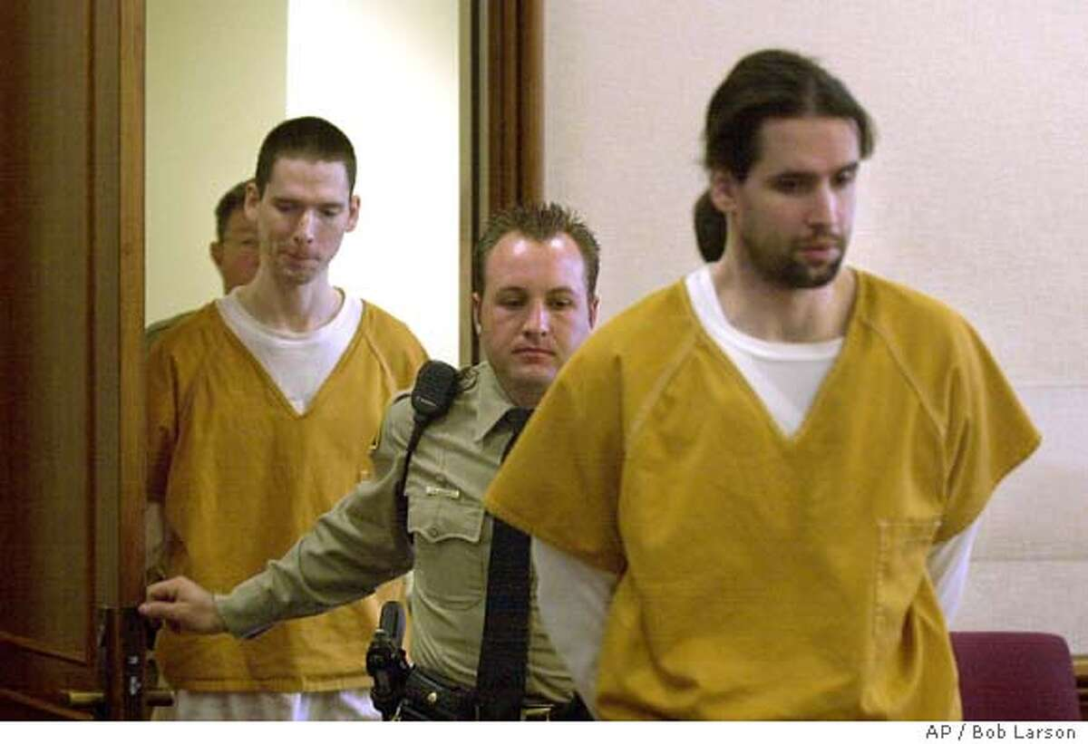 Brothers Justin Helzer, 29, left, and Glenn Helzer, 31, are led into court for a preliminary hearing in Martinez, Cailf., Monday Dec. 3, 2001. The Helzers and their housemate Dawn Godman, 27, are accused of going on a killing spree that left five people dead including Selina Bishop, the daughter of blues guitarist Elvin Bishop. (AP Photo/Contra Costa Times, Bob Larson ) Ran on: 06-10-2004 Carma Helzer leaves the Martinez Courthouse after her sons arraignment.