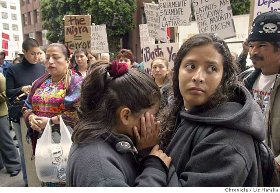 Ma. del Carmen Coronado (cq, right) and her daughter Teresa Coronado protesting recent federal immigration raids in the Mission District in front of the Bureau of Immigration and Customs Enforcement offices. Shot on 6/23/04 in San Francisco. LIZ HAFALIA / The Chronicle Photo: LIZ HAFALIA