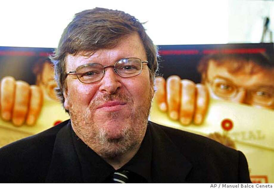 "**RETRANSMISSION TO CORRECT OBJECT NAME** Michael Moore arrives for the preview of his documentary, ""Fahrenheit 9/11,"" in Washington, Wednesday night, June 23, 2004. (AP Photo/Manuel Balce Ceneta) **RETRANSMISSION TO CORRECT OBJECT NAME** Photo: MANUEL BALCE CENETA"