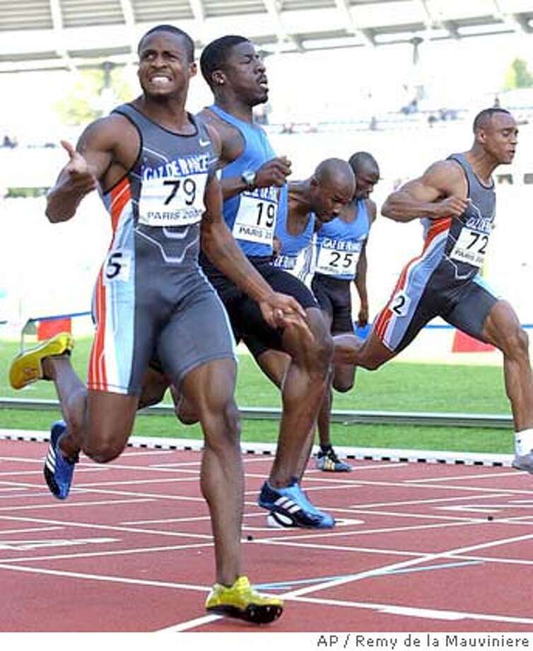 ** FILE ** Tim Montgomery, left, of the USA, crosses the finish line to win the men's 100m race during the final of the IAAF Grand Prix track and field meeting at the Charlety stadium in Paris, Saturday, Sept. 14, 2002. The U.S. Anti-Doping Agency plans to seek a lifetime ban against 100-meter world record holder Montgomery for alleged drug violations, The Associated Press has learned. Montgomery was notified Wednesday, June 23, 2004,according to a source familiar with the letter who spoke to TheAP on condition of anonymity. (AP Photo/Remy de la Mauviniere,file) SEPT. 14, 2002 FILE PHOTO Photo: REMY DE LA MAUVINIERE