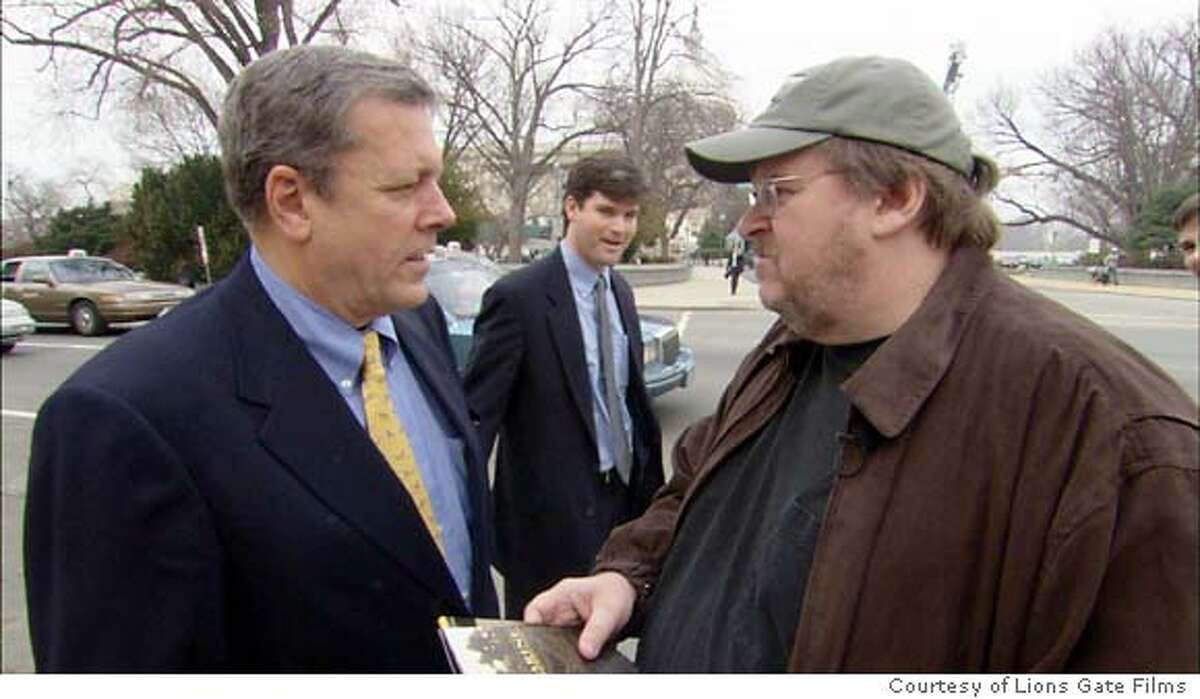 Michael Moore talking with Congressman John Tanner (D-TN) on Capitol Hill. He spent the day there approaching pro-war members of Congress to recruit their children to fight in Iraq in Lions Gate Films'