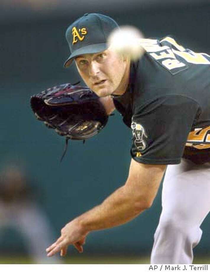 Oakland Athletics pitcher Mark Redman throws to the plate during the first inning against the Anaheim Angels, Wednesday night, June 23, 2004, in Anaheim, Calif. (AP Photo/Mark J. Terrill) Photo: MARK J. TERRILL