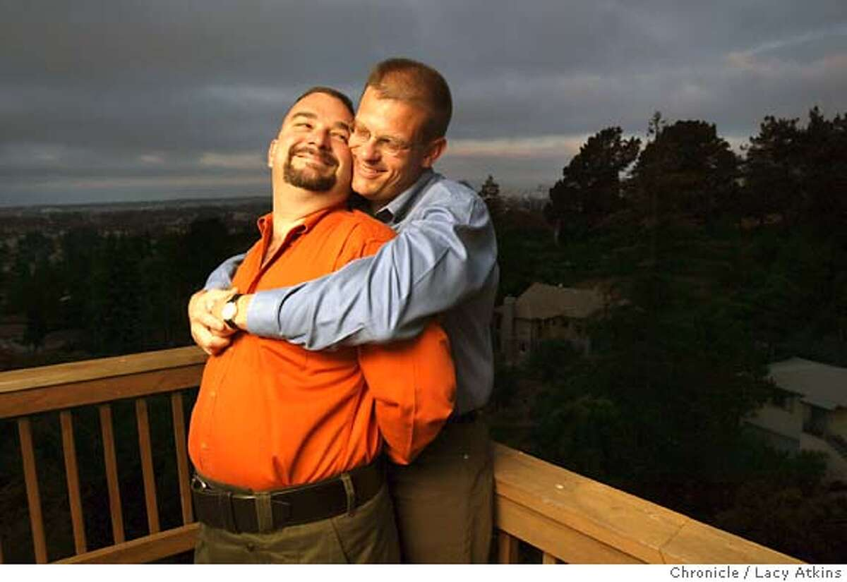 A. J. Alfieri-Crispin and life partner Kevin Crispin-Alfieri on their back deck over looking the Oakland Hill, Thursday morning June 24, 2004. They have lived in Oakland for four years on their eleven years together. Oakland is home to more lesbian couples per capita than any other major American city and ranks third in gay and lesbian households behind San Francisco and Seattle according to census data, Thursday June 24, 2004. LACY ATKINS / The Chronicle