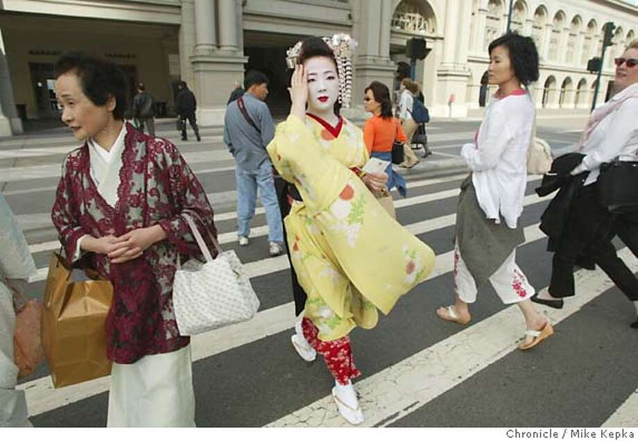 Japanese apprentice geisha, Umechika, 20, visits the Ferry building during a day of tourism after she and another Geisha named Uneha, 25, were helping with the Geisha exhibit at the Asian Art Museum.  6/23/04 in San Francisco. Mike Kepka / The Chronicle Photo: Mike Kepka