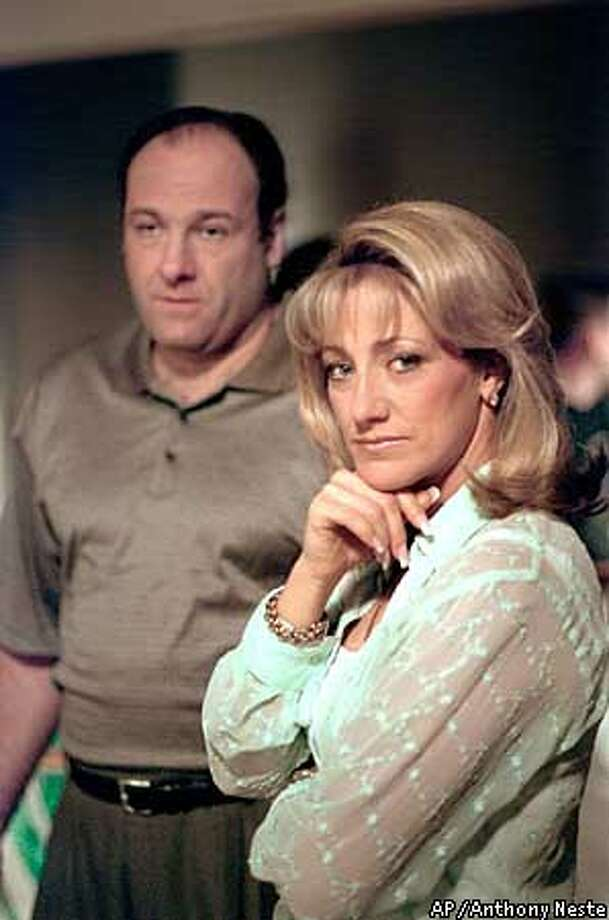 "FILE--James Gandolfini and Edie Falco of the HBO drama series ""The Sopranos,"" are shown in this undated file photo. The television show received 18 in Los Angeles, Thursday morning Juny, 20, 2000. Gandolfini and Falco received best actor/actress in a drama series nominations. (AP Photo/Anthony Neste, File) Photo: ANTHONY NESTE"