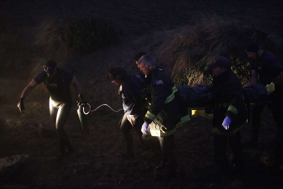 Emergency responders carry one of the victims of an overturned boat off of Ocean Beach to an ambulance after their boat overturned near San Francisco's Ocean Beach on Thursday, January 26, 2012 in San Francisco, Calif. Photo: Lea Suzuki, The Chronicle