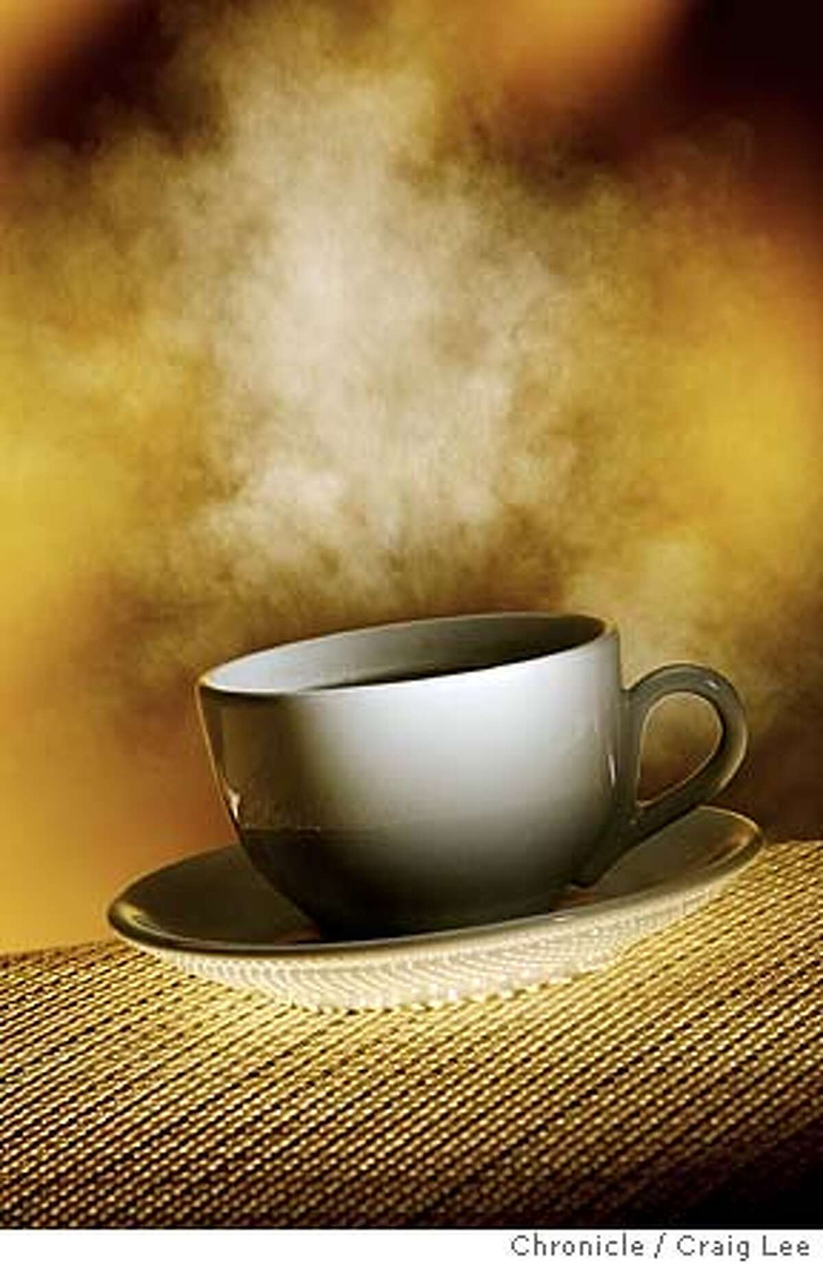Photo illustration of a steaming cup of coffee. Event on 6/9/04 in San Francisco. Craig Lee / The Chronicle
