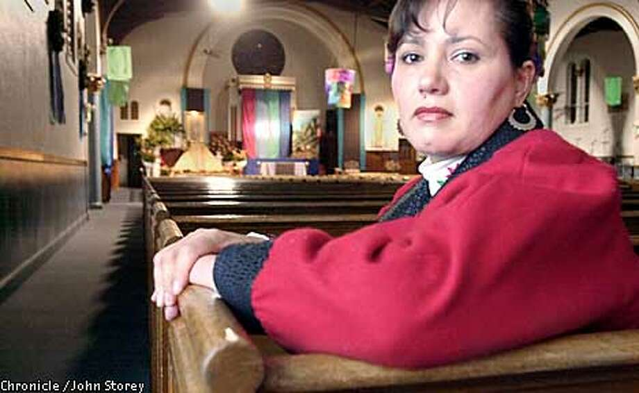OUTREACH-C-09DEC02-MT-JRS-Guillermina Arias at St. peter Martyr Church in Pittsburg. Story about how she doesn't want her sons to go to war. Chronicle photo by John Storey.