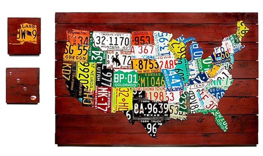 "State of the Union map by Aaron Foster for Uncommon Goods. Each state is represented by an authentic license plate and mounted on a painted, cedar background, with  Alaska and Hawaii included on separate boards. Each map is one-of-a-kind and comes with ""D"" rings attached to the back for mounting. Handmade in California. $3,000.00"