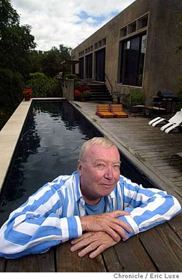 Environmmental portrait of author Stanley Abercrombie in his living room and in his pool with his home behind him. Also his recent book A Century of Interior Design  5/28/04 Sonoma  Eric Luse Photo: Eric Luse