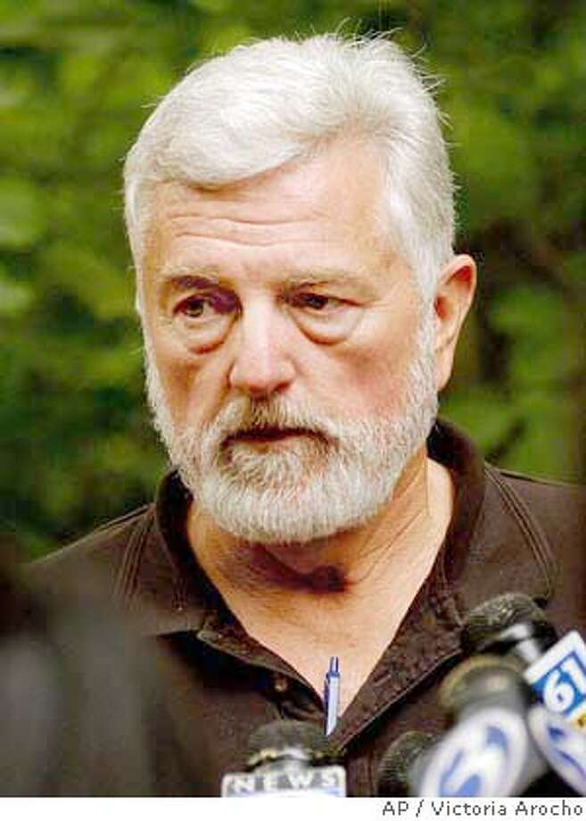 James Cheatham, president of Verticare, out of Salinas, Calif., speaks with members of the media Friday, June 18, 2004 near a helicopter owed by his company crashed in Killingly, Ct. Cheatham's Robinson R44 helicopter crash landed in a wooded area adjacent to Ross Rd near Old Furnace State Park killing the two people onboard. The helicopter was on its way to the Rhode Island National Guard Airshow at Quonset Point in North Kingston, R.I. (AP Photo/Victoria Arocho) Photo: VICTORIA AROCHO