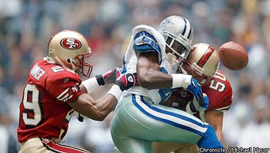 Cowboys 84- Joey Galloway losses the ball as he is hit by 49ers 29- Ahmed Plummer and 50- Derek Smith in the 1st quarter. San Francsico Forty Niners v. Dallas Cowboys at Texas Stadium, Irving, Texas, Dec. 8, 2002. by Michael Macor/The Chronicle Photo: MICHAEL MACOR