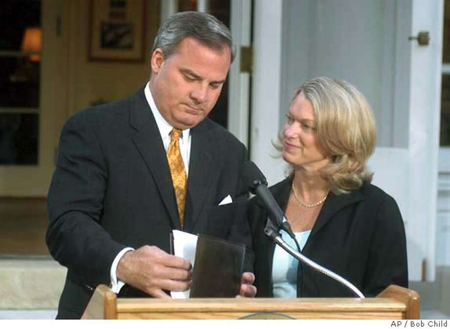 Connecticut Gov. John G. Rowland, with his wife Patty beside him, finishes his speech after he announced his resignation from office at the Governor's Residence in Hartford, Conn., Monday, June 21, 2004. Rowland said he will resign effective at noon, July 1, 2004. (AP Photo/Bob Child) Photo: BOB CHILD