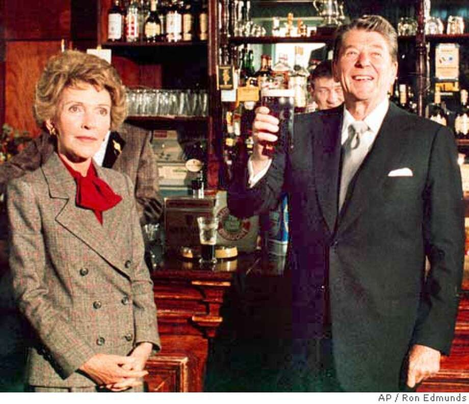 U.S President Ronald at the bar in O'Farrell's Pub in the village of Ballyporeen, Ireland, June 3, 1984. Accompanied by his wife Nancy, the President was visiting the village where his ancestors originated during a four-day visit to the Irish Republic. (AP Photo/Ron Edmunds) Photo: RON EDMUNDS