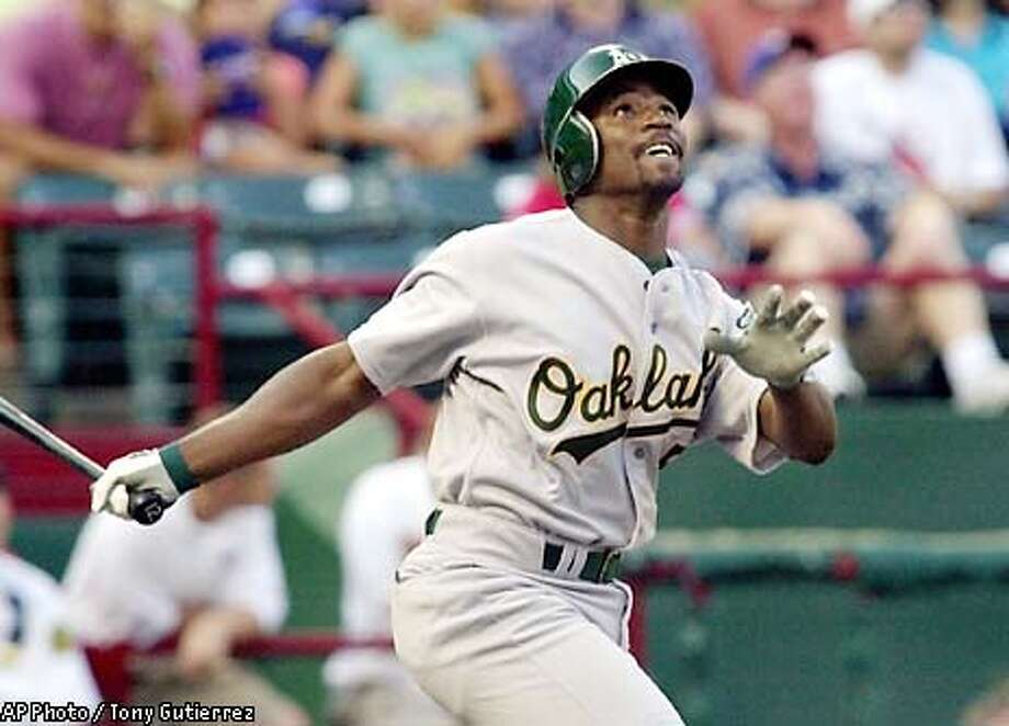 Oakland Athletics' Ray Durham watches his hit go foul in the first inning against Texas Rangers starting pitcher Rob Bell Friday July 26, 2002, at the Ballpark in Arlington, Texas. (AP Photo/Tony Gutierrez) Photo: TONY GUTIERREZ