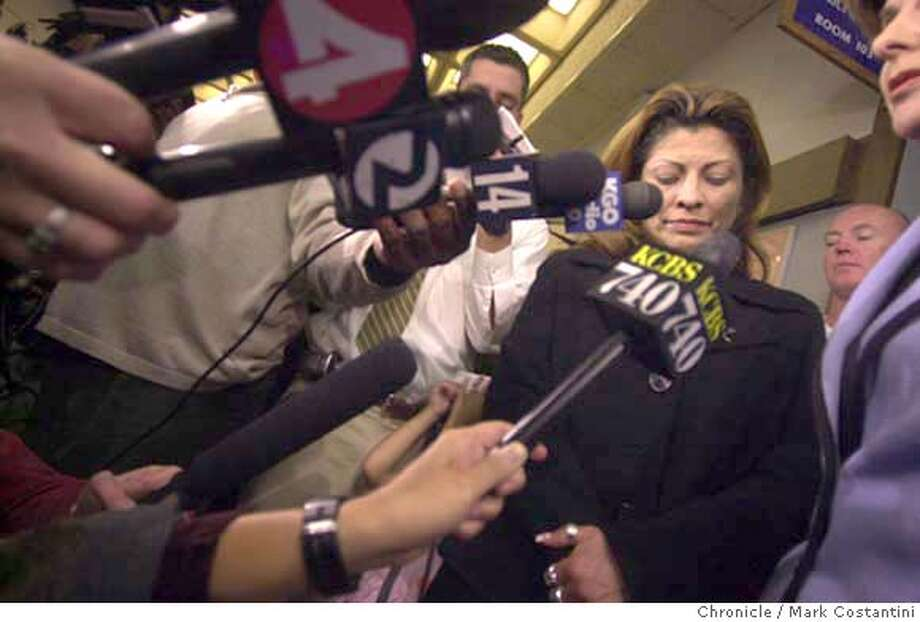 ARAUJO_083.JPG Photo taken on 6/23/04 in HAYWARD.  Gwen's mother Sylvia Guerrero(directly above KCBS microphone) outside DA's office after declaration of mistrial. She was to apeak with the media but decided she was too upset and ultimately left the building.  cene outside court after the Gwen Araujo murder trial ended in a mistrial.  Photo: Mark Costantini/SF Chroniclerial Photo: MARK COSTANTINI