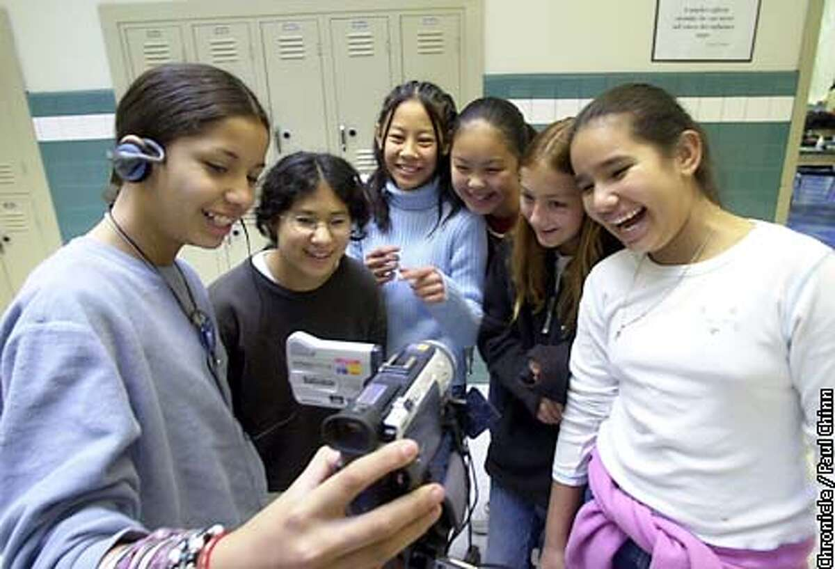 From left, Kenia Lacayo, Aisha DeAvila-Shin, Kieu Tran, Pauline Ng, Laurel Picklum, and Lizette Alonso taped a scene for their video production. Oakland teacher Anthony Cody is concerned that his Tech Bridge class for girls will be slashed from next year's budget. PAUL CHINN/S.F. CHRONICLE