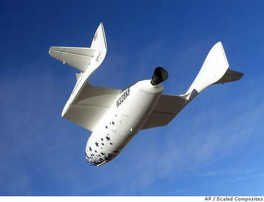 ** FILE ** SpaceShipOne glides to an approach to the Mojave, Calif., airport following a test flight in this recent undated file photo. On Monday, June 21, 2004, SpaceShipOne is scheduled to be carried aloft to be released and try to climb 62 miles high, leaving Earth's atmosphere for a few minutes to become the first privately funded, non-governmental manned spacecraft. (AP Photo/Scaled Composites) UNDATED FILE PHOTO,