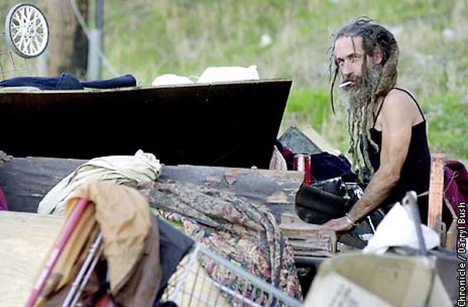 "GRIMES2-C-26NOV02-MT-DB Grimes Poznikov plays a piano he lives by in a homeless encampment under Highway 280 near the railroad tracks in the Bayview District. Poznikov once played trumpet as a street performet known as the ""human jukebox"" in San Francisco. CHRONICLE PHOTO BY DARRYL BUSH Photo: Darryl Bush"