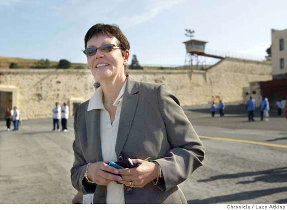 California Department of Corrections director Jeanne Woodford walks through the Yard at San Quentin Prison, Saturday May 1, 2004. She was the warden for 25 years and this is her first visits since leaving Feb 23, 2004, when she moved up the Sacramento to help clean-up the CDC budget problems.  LACY ATKINS / The Chronicle Photo: LACY ATKINS
