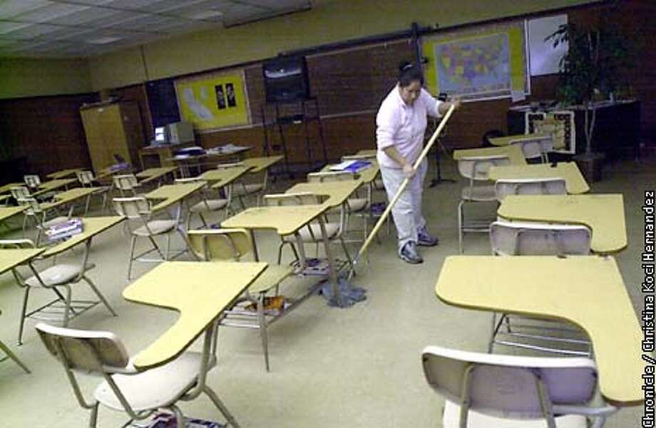 CHRISTINA KOCI HERNANDEZ/CHRONICLE  Noemi Martinez,a janitor, cleans a classroom after school. Conditions at Kennedy High School in Richmond. Photo: CHRISTINA KOCI HERNANDEZ