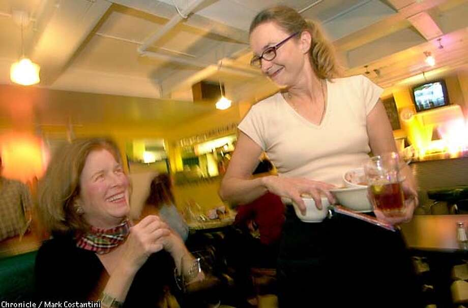 Author Alison Owings, left, shares a laugh with one of her favorite waitresses, Candy Bates, at the Cactus Cafe in Mill Valley. Chronicle photo by Mark Costantini