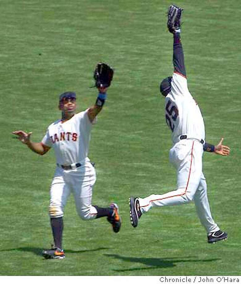 SBC Park. San Francisco, CA  Barry Bonds and Marquis Grissom go for the same fly ball . Bond lept high to catch the hit from Johnny Damon. there were two men on.  Giants V/S Boston  photo/John O'Hara Photo: John O'Hara