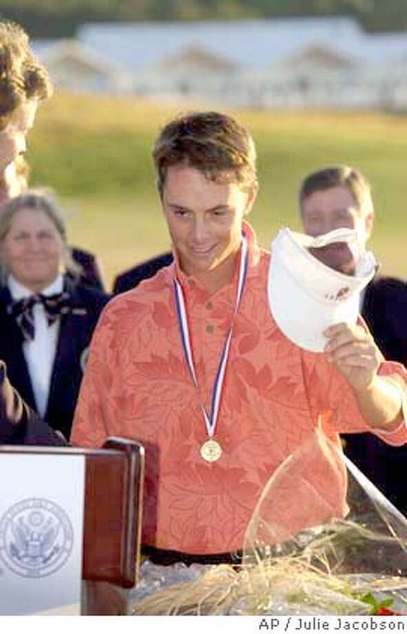 Low Amateur Spencer Levin, of Elk Grove, Calif., smiles while receiving the award for low amateur in the U.S. Open Sunday, June 20, 2004, at Shinnecock Hills Golf Club in Southampton, N.Y. (AP Photo/Julie Jacobson) Photo: JULIE JACOBSON