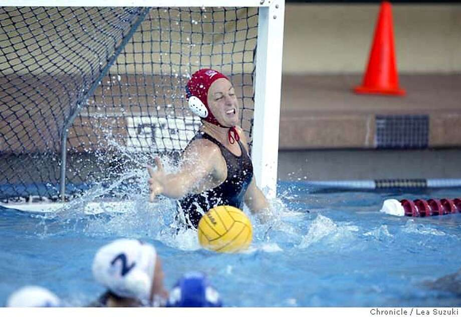 Goalie Jackie Frank reaches out to block a goal attempt in the fourth period. U.S. Women's Olympic Water Polo Team to face Hungary's Olympic Water Polo team at Stanford's Avery Aquatic Center. Photo taken on 6/20/04 in STANFORD, CA.  Lea Suzuki/ San Francisco Chronicle Photo: Lea Suzuki