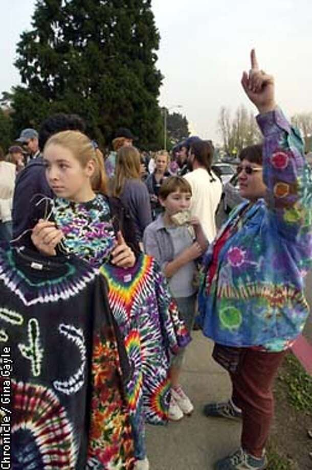 Part of the Jenkins family from Wolf Creek, Oregon sells t-shirts and kid friendly rice krispy treats trying to earn enough for five tickets to The Others' concert in Oakland. L-R Chelivy,15, Brittany,10 and mom Therese. The girls would rather be at home listening to any other music but the Grateful Dead's. Photo by Gina Gayle/The SF Chronicle. Photo: GINA GAYLE