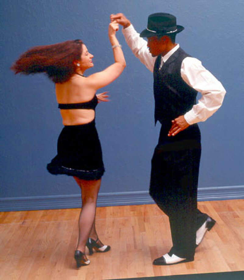 Dance teachers Ava Apple and Phil Haymon practice their salsa moves at the Metronome Ballroom.