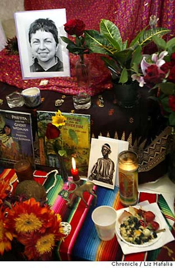 ANZULDUA_010_LH.JPG Chicana feminist lesbian poet/writer Gloria Anzuldua is memorialized at a recent gathering in the Women's Building in the Mission, where an altar has been set up with her photos, flowers, and memorabilia. Shot on 6/14/04 in San Francisco. LIZ HAFALIA / The Chronicle MANDATORY CREDIT FOR PHOTOG AND SF CHRONICLE/ -MAGS OUT Photo: LIZ HAFALIA
