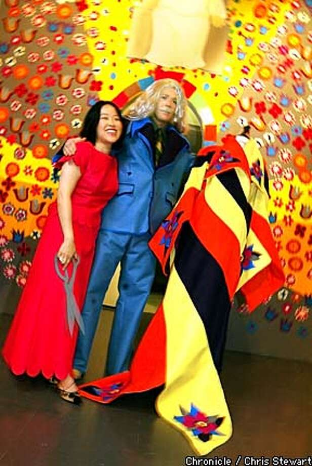 "Fashion designer Colleen Quen was inspired to create dresses in felt by artist Frank Haines, who has filled a room at the Yerba Buena Center for the Arts with ""Valiant Phantasm,"" a felt fantasy of medieval design and flower power. Chronicle photo by Chris Stewart"