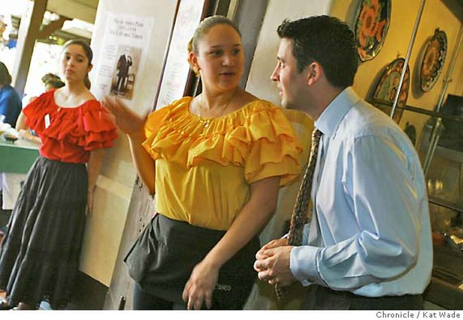 (Right to Left) Don Luis Camacho, Esq.,30, a registered Democrat, is president of Camacho's Inc., his family's string of restaurants including El Paseo on Main Street in historic Los Angeles where he talks with server, Patricia Contreras, while hostess Jessica Tort looks on in Los Angeles on Cinco de Mayo 5/5/04. Kat Wade/The Chronicle Photo: Kat Wade