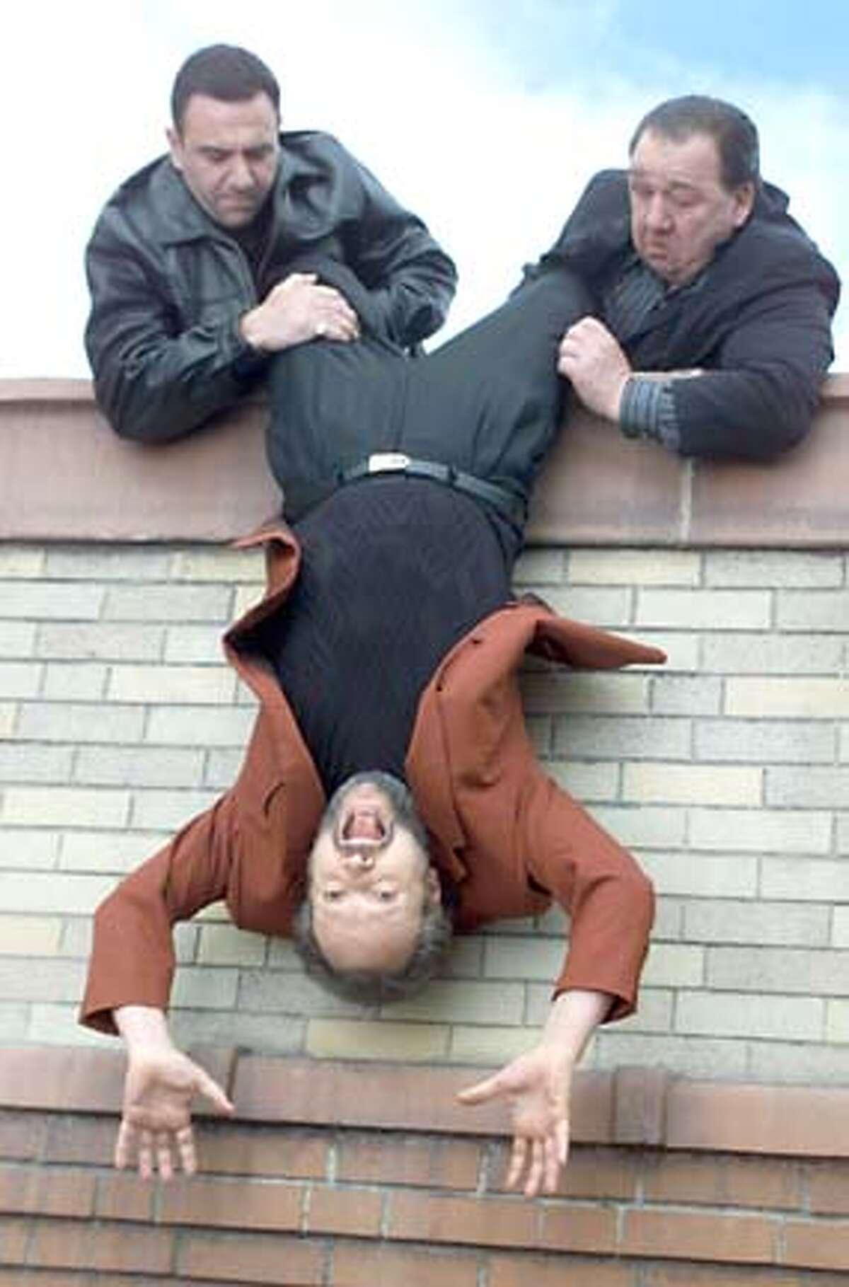 Alfred Sauchelli Jr., left, and Joe Viterelli turn Billy Crystal's world upside down in