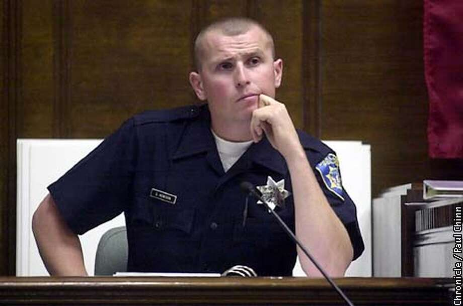Oakland police officer Steve Hewison testified during cross examination in the Oakland police Riders trial Wednesday.  PAUL CHINN/S.F. CHRONICLE Photo: PAUL CHINN