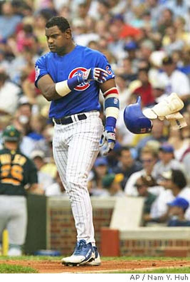 Chicago Cubs' Sammy Sosa tosses his helmet and shin guard after striking out to end the sixth inning against the Oakland Athletics Friday, June 18, 2004 in Chicago. Sosa went 0-for-4 in his first game since May 16 helping the A's to a 2-1 victory. (AP Photo/Nam Y. Huh) Photo: NAM Y HUH