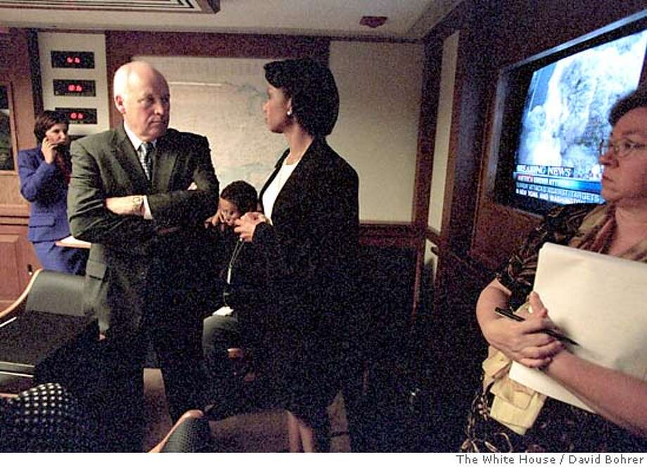 (NYT44) WASHINGTON -- June 17, 2004 -- TERROR-ASSESS -- Vice President Dick Cheney and National Security Advisor Condoleezza Rice talk in the Presidential Emergency Operation Center at the White House Sept.11, 2001. With its bold rewriting of the history of the Sept. 11 attacks, an independent commission that President Bush tried to block has delivered on some of the White House's worst fears. Far from a bolt from the blue, the panel has demonstrated over the last 19 months that the Sept. 11 attacks were foreseen, at least in general terms, and might well have been prevented, had it not been for misjudgments, mistakes and glitches, some within the White House itself. (David Bohrer/The White House) Photo: David Bohrer