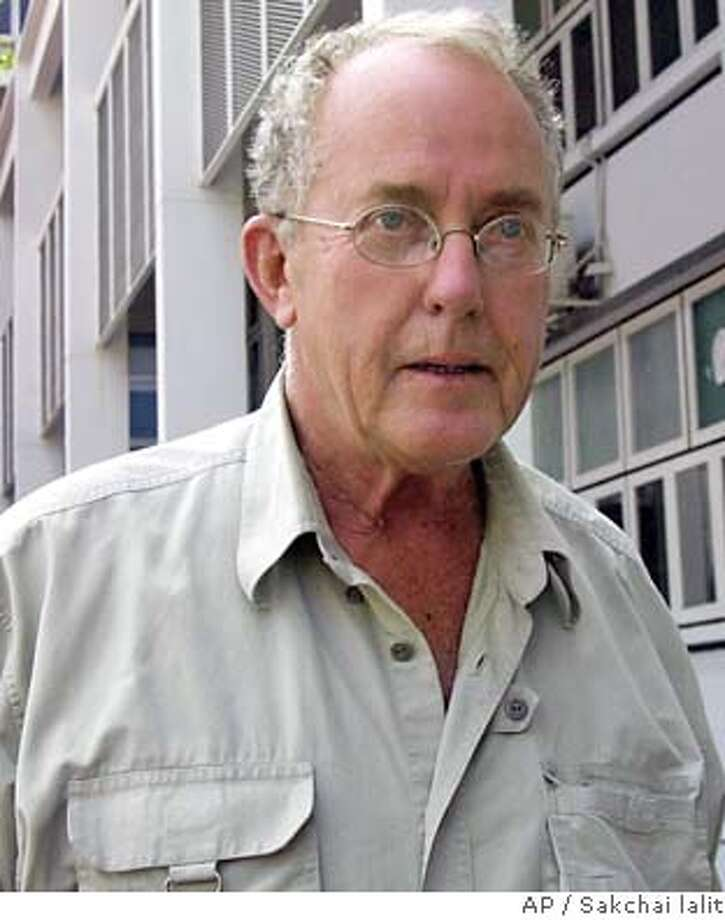 Thomas Frank White, a 67-year-old American from San Francisco, Calif., wanted in Mexico for allegedly molesting and raping minors, is being escorted by police from Thailand's crime suppression division to a Bangkok prison Thursday Feb. 13, 2003. He was arrested Tuesday evening in Bangkok and is awaiting an extradition hearing.(AP Photo/Sakchai lalit) Photo: SAKCHAI LALIT