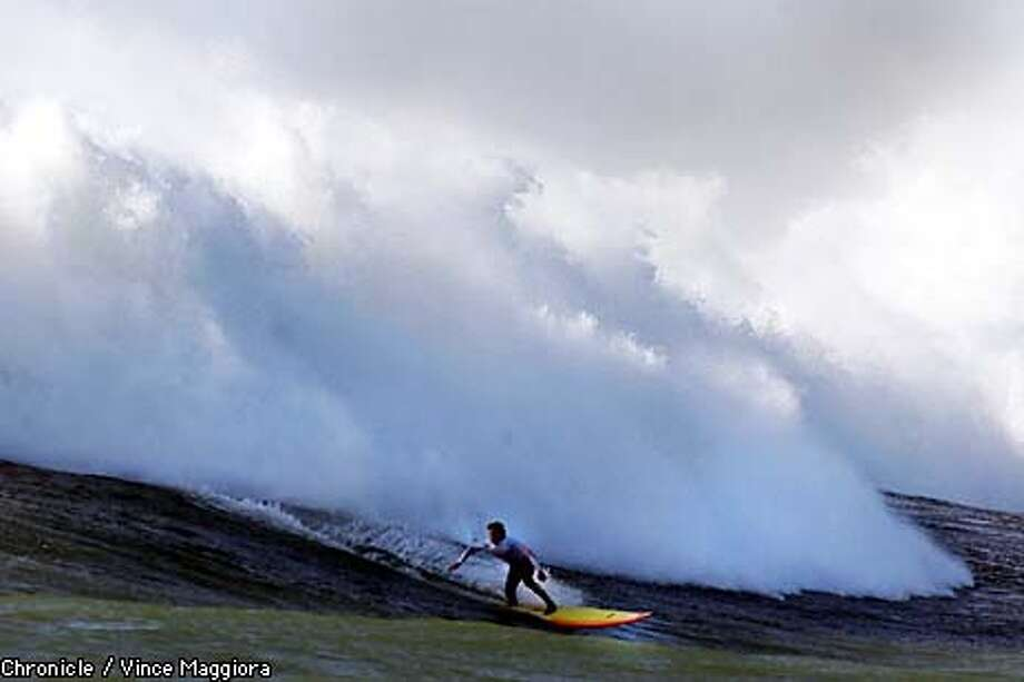 "MAVSURF4-C-03MAR00-MN-VM Darryl ""Flea"" Viorstko on a wave at the Quicksilver surf contest at Mavericks on the north end of Half Moon Bay .Surfers from around the world compete in 20 to 30 foot waves off the Ca. coast.  by Vince Maggiora Photo: VINCE MAGGIORA"