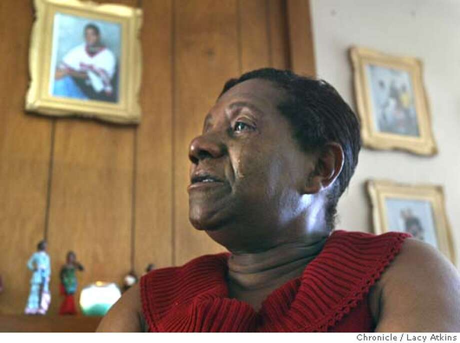 "Wanda Elston, Great-aunt of Scharod Fleming, cries as she talks about the ""Let the Children Dance Foundation"", at her home in San Francisco June 15, 2004, as she remembers Scharods killing outside a dance party in the Tenderloin. The pictures on the wall along with a candle is a shrine for Scharod.  LACY ATKINS / The Chronicle Photo: LACY ATKINS"