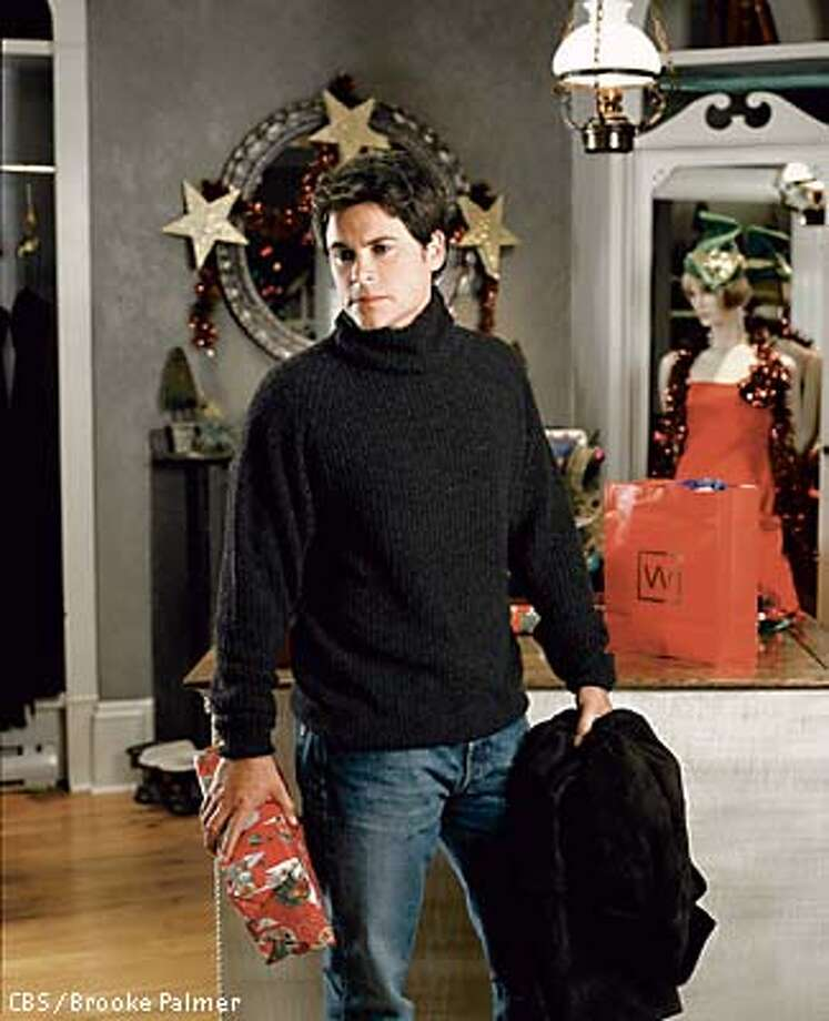 caption: Rob Lowe stars as Robert Layton in the new holiday television movie THE CHRISTMAS SHOES to air Sunday, Dec. 1 (9:00-11:00 PM, ET/PT) on the CBS Television Network.  copyright: Photo: Brooke Palmer/CBS  �2002 CBS WORLDWIDE INC. ALL RIGHTS RESERVED.  HANDOUT PHOTO Photo: HANDOUT