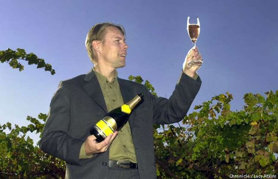 Mike Sjoeblom and his new champagne made out of cabernet sauvignon grape which turns out to be a pretty rose color.  SAN FRANCISCO CHRONICLE/LACY ATKINS Photo: LACY ATKINS