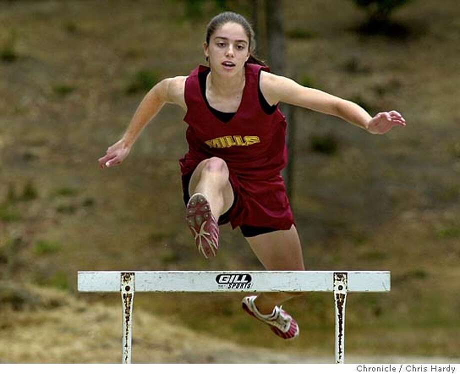 Mills High sophomore track hurdler Keriann Aronson, the granddaughter of former St. Mary's College football great Harry Aronson, qualified for the state meet in the 300-meter hurdles this spring season, after winning both the 300 hurdles and pole vault titles at the Peninsula Athletic League meet.  at Millbrae,CA on 6/9/04  San Francisco Chronicle/Chris Hardy Photo: Chris Hardy